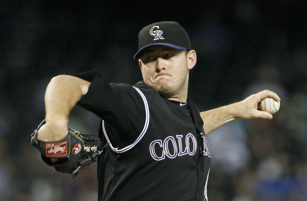 . Starting pitcher Tyler Matzek #46 of the Colorado Rockies delivers a pitch against the Arizona Diamondbacks during the first inning of a MLB game at Chase Field on August 30, 2014 in Phoenix, Arizona. (Photo by Ralph Freso/Getty Images)
