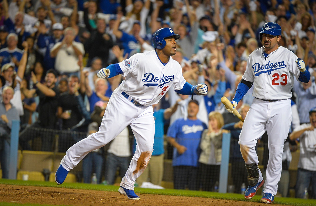 . Dodgers\' Carl Crawford scores in game 3 of the NLCS series at Dodger stadium Monday, October 14, 2013 ( Photo by Andy Holzman/Los Angeles Daily News )