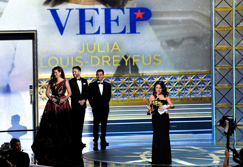 """. Julia Louis-Dreyfus accepts the award for outstanding lead actress in a comedy series for \""""Veep\"""" at the 69th Primetime Emmy Awards on Sunday, Sept. 17, 2017, at the Microsoft Theater in Los Angeles. (Photo by Chris Pizzello/Invision/AP)"""