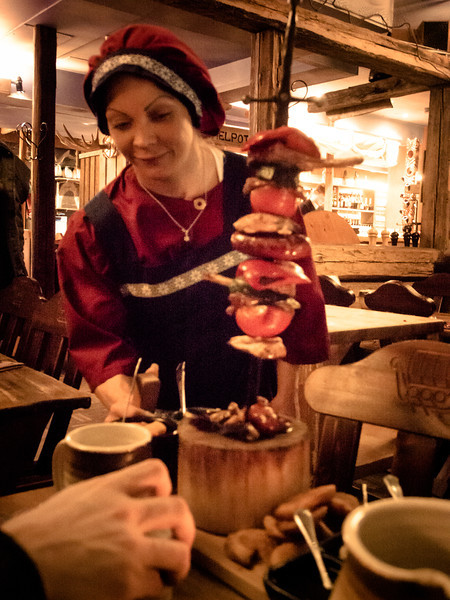 tampere viking meat on a stick with server.jpg
