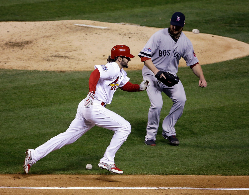 . Boston Red Sox starting pitcher Jon Lester gets a bunt hit by St. Louis Cardinals\' Pete Kozma (38) during the third inning of Game 5 of baseball\'s World Series Monday, Oct. 28, 2013, in St. Louis. (AP Photo/Jeff Roberson)