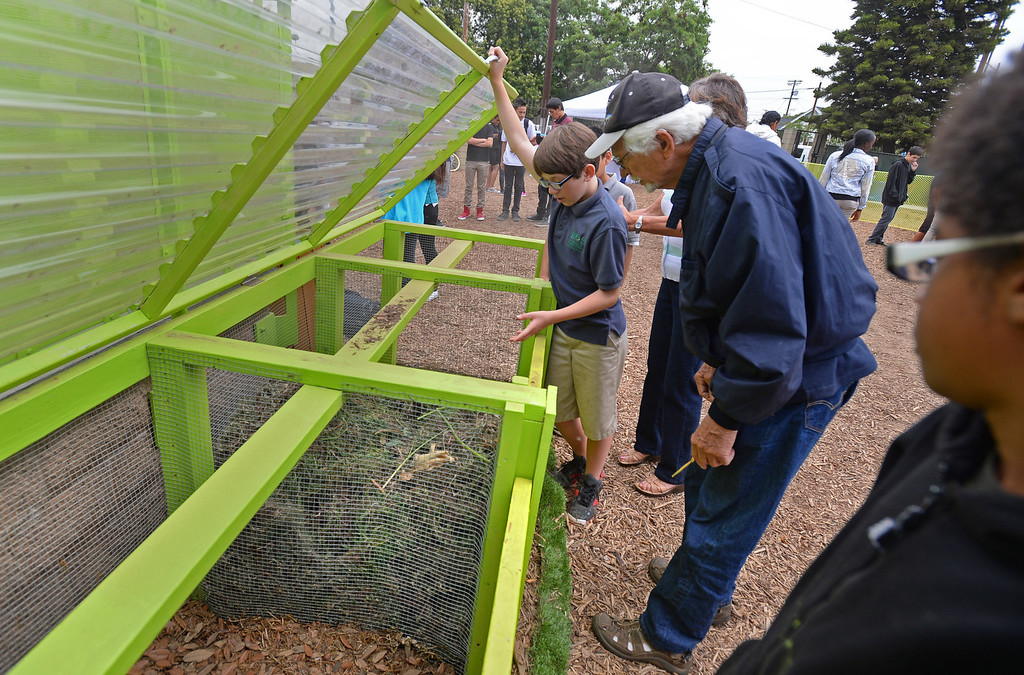 . New Environmental Charter Middle School in Gardena is located on the property of a former church. It serves about 360 students. Ethan Cusick, 6th grade, demonstrates how the school compost bins work.  Photos by Brad Graverson 5-22-13