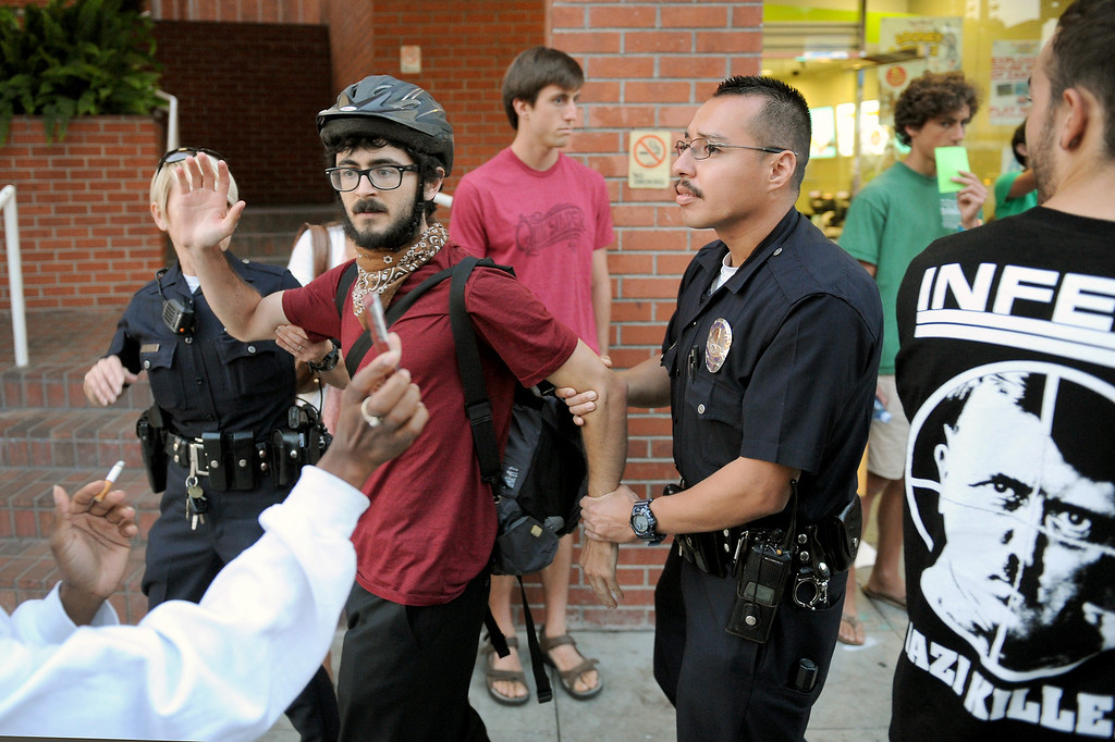 """. LAPD arrests a protester during a \""""Smash White Supremacy Fun Run\"""" in Westwood, Thursday, July 18, 2013. (Michael Owen Baker/L.A. Daily News)"""
