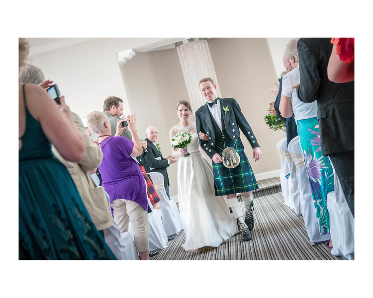 Wedding Photography of Susan & Ross, Barony Castle, Peebles, Scotland, Phography is of the Bride & Groom walking up the aisle after the cermony