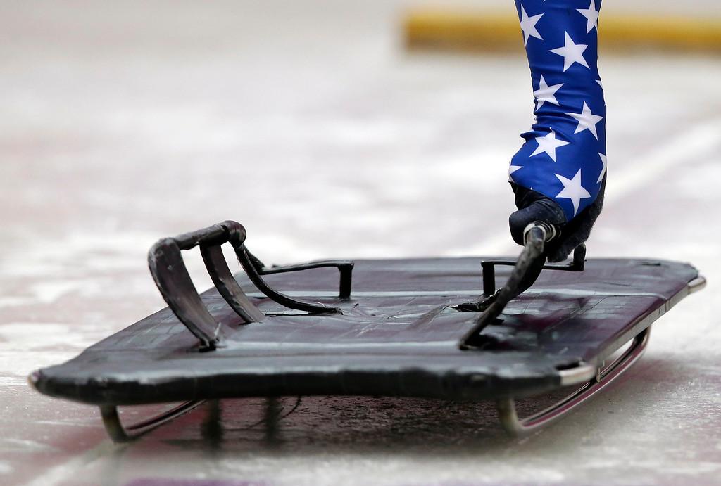 . John Daly of the United States prepares to slide during the men\'s skeleton singles training at the 2014 Winter Olympics, Monday, Feb. 10, 2014, in Krasnaya Polyana, Russia. (AP Photo/Dita Alangkara)