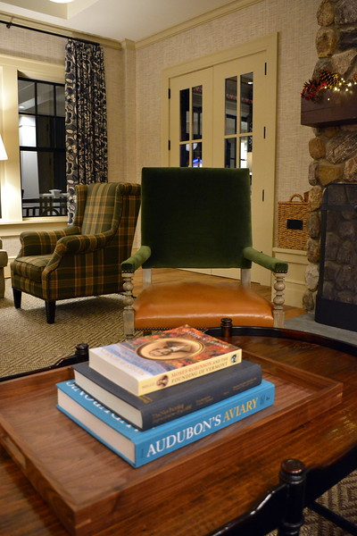 Books and seating near the double-sided fireplace in the lobby of the Taconic Hotel in Manchester, VT