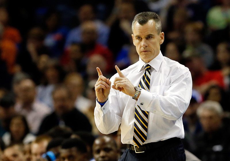 . Head coach Billy Donovan of the Florida Gators motions to his players during the south regional final of the 2014 NCAA Men\'s Basketball Tournament against the Dayton Flyers at the FedExForum on March 29, 2014 in Memphis, Tennessee.  (Photo by Kevin C. Cox/Getty Images)