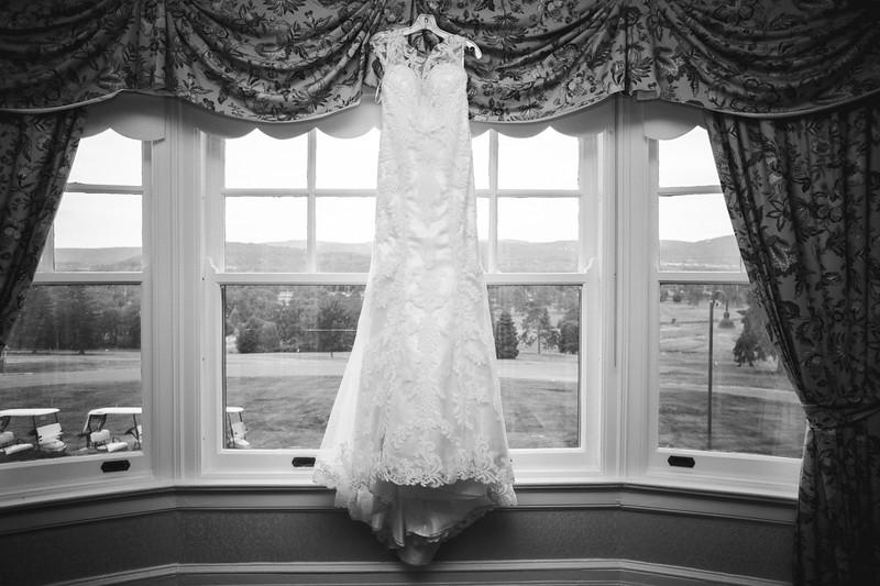 Wedding dress hanging in a window.