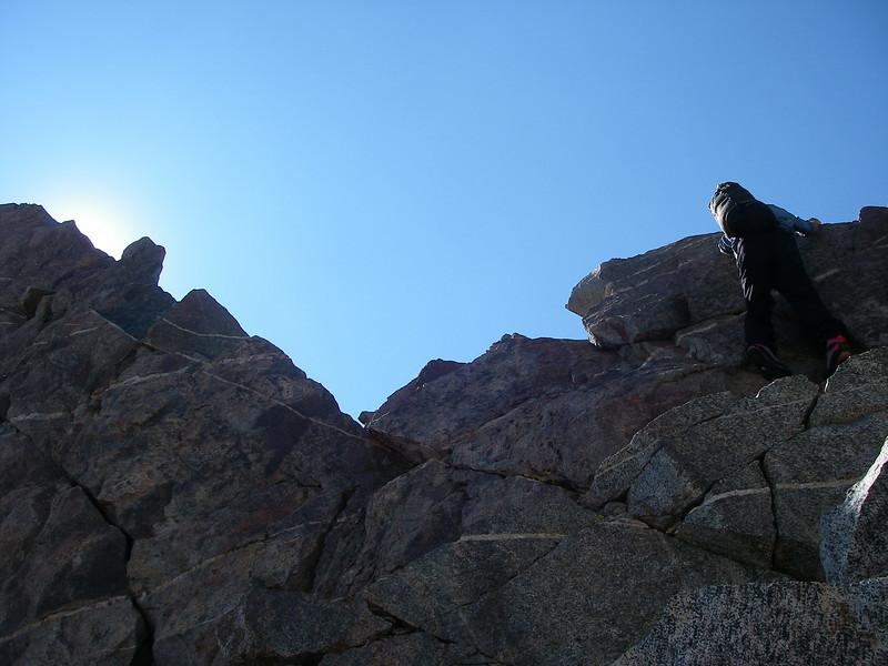 Climbing down exposed ridge ...
