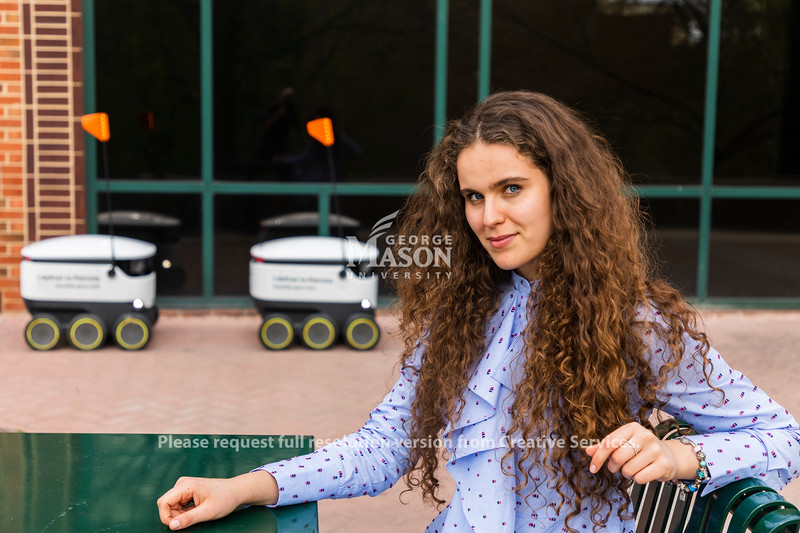 """Sofya Vetrova created the """"Robot Exclusive,"""" a newsletter packed with information about events, Mason Dining news and coupons that comes with Starship delivery orders.  Photo by Lathan Goumas/Strategic Communications"""
