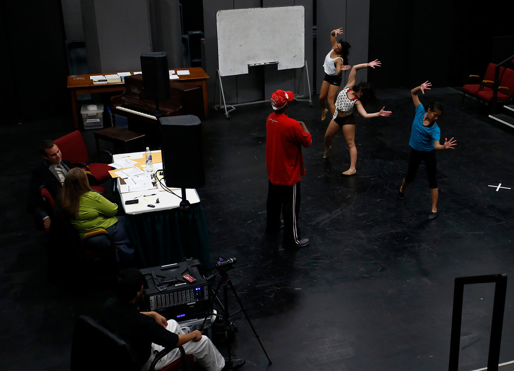 . Desi Hyter, center in red, choreographer for Great America, leads Marissa Gomez, top right, Marissa Dutra, middle right, and Angelique Gorospe, bottom right, during a dance audition during a casting call for Great America theme park for their various characters and dancers in Hall Todd Theatre at San Jose State University on Wednesday, Feb. 6, 2013.  (Nhat V. Meyer/Staff)
