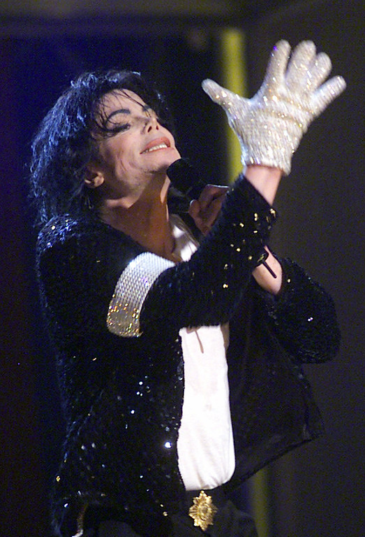 ". Michael Jackson sports his trademark glove as he performs ""Billie Jean\"" during his \""30th Anniversary Celebration, The Solo Years\"" concert at New York\'s Madison Square Garden, Friday, Sept. 7, 2001. (AP Photo/Beth A. Keiser, Pool)"