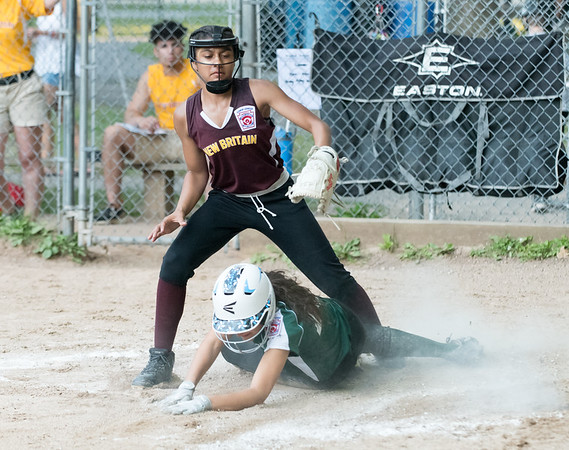 07/02/18 Wesley Bunnell | Staff New Britain vs Bristol district 5 softball tournament game at Rockwell Park on Monday evening. Pitcher Abby Wooten (7) straddles Bristol's Lilly Lowe (13) after unsuccessfully attempting the tag while covering home.
