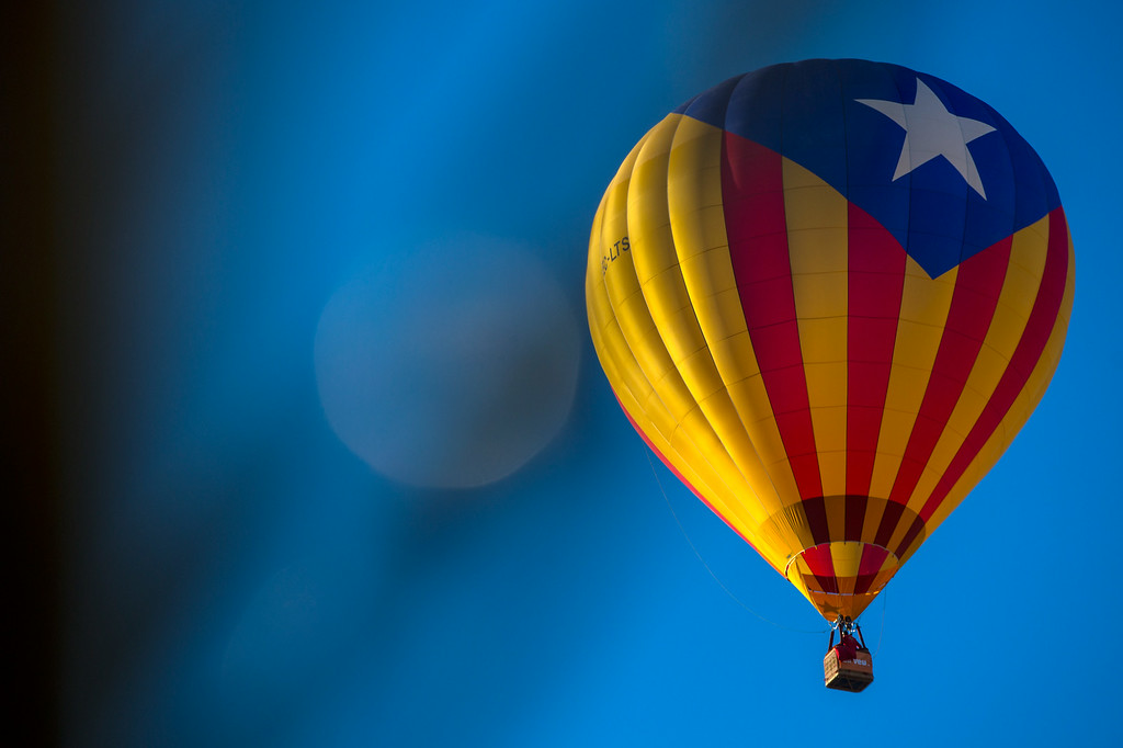 . A hot air balloon with a Catalan pro-independence flag flies over Igualada during an early flight as part of the European Balloon Festival on July 10, 2014 in Igualada, Spain.  (Photo by David Ramos/Getty Images)