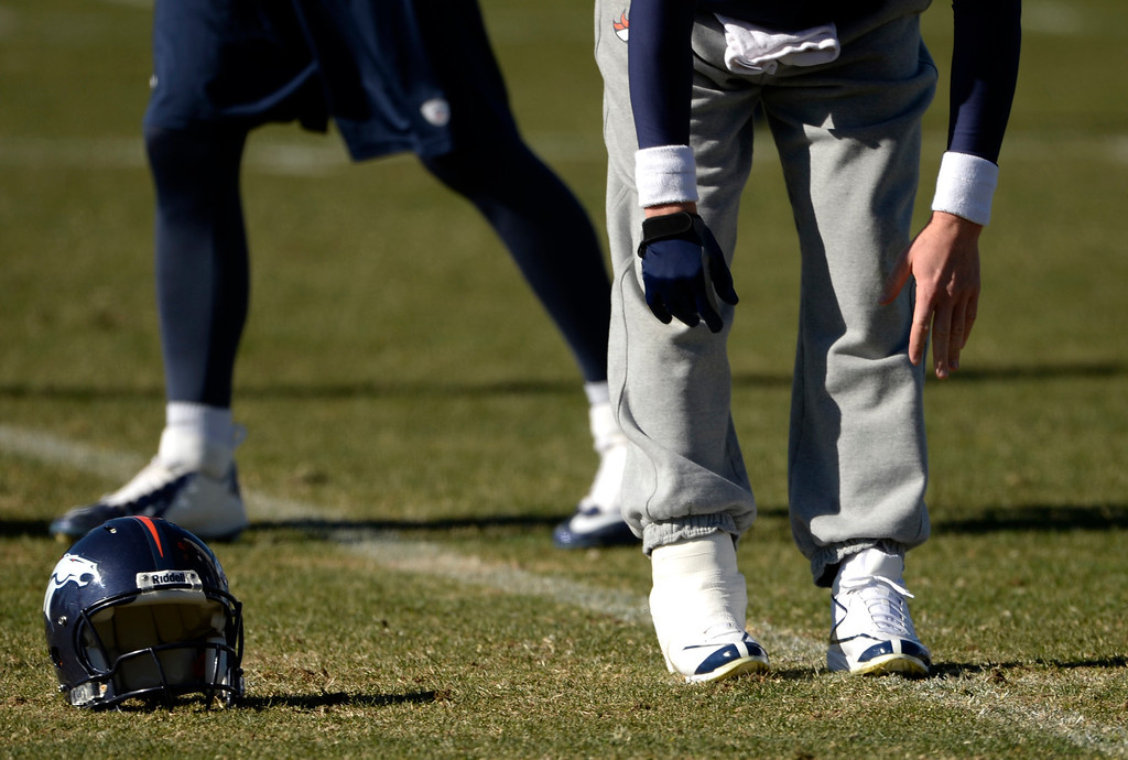. Peyton Manning works out durning the Denver Broncos practice at Dove Valley, November 14, 2013. Manning\'s right ankle was taped during the workout. (Photo by RJ Sangosti/The Denver Post)