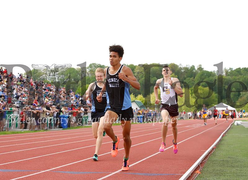 Seneca's Sam Owori (center) finished third in 1,600 meter. Connor Volk-Klos finished fourth (left). Dylan Binda of Greensburg Salem finished fifth. Seb Foltz/Butler Eagle