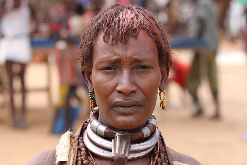 Hamer woman with necklace indicating that she is a first wife.