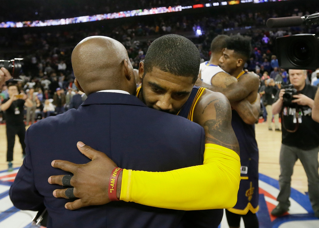 . Cleveland Cavaliers guard Kyrie Irving hugs a staff member after Game 4 of a first-round NBA basketball playoff series against the Detroit Pistons, Sunday, April 24, 2016 in Auburn Hills, Mich. Irving had 31 points in the Cavaliers 100-98 win. (AP Photo/Carlos Osorio)