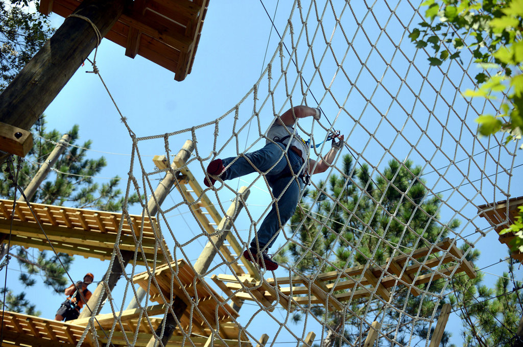 . A man climbs the rope ladder at the Aerial Adventure Park at Trollhaugen. (Pioneer Press: Chris Polydoroff)