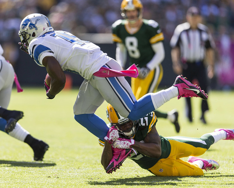 . Jerron McMillian #22 of the Green Bay Packers makes a tackle on Micheal Spurlock #15 of the Detroit Lions at Lambeau Field on October 6, 2013 in Green Bay, Wisconsin.  (Photo Tom Lynn /Getty Images)