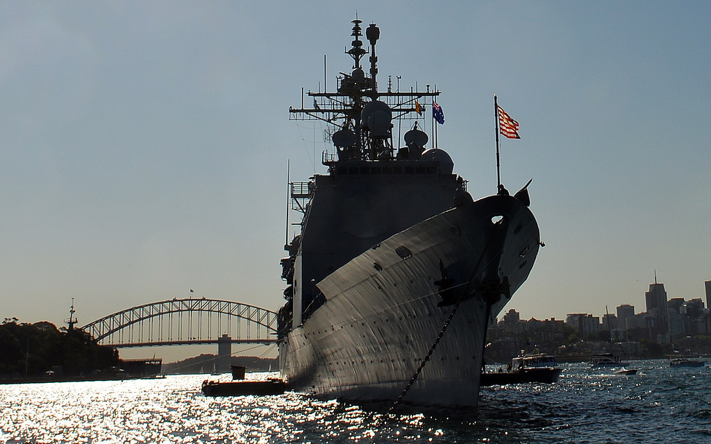 . US navy warship, forward-deployed Ticonderoga-class cruiser USS Chosin (CG 65), docks at the Sydney Harbour in front of the Harbour Bridge on October 4, 2013. Ships from nations including China, Thailand, the United States, Malaysia, France, Japan and former colonial power Britain passed through the heads into the famous harbour where they joined 16 tall ships from around the world in preparation for a ceremonial fleet review on October 5, 2013.  SAEED KHAN/AFP/Getty Images