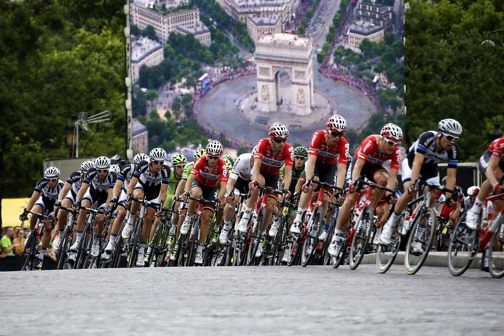 . The pack rides on the Champs Elysee avenue during the 137.5 km twenty-first and last stage of the 101st edition of the Tour de France cycling race on July 27, 2014 between Evry and Paris.    KENZO TRIBOUILLARD/AFP/Getty Images