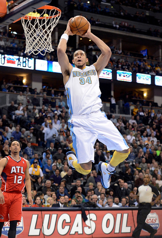 . JaVale McGee (34) of the Denver Nuggets goes up for a monster dunk during the second quarter against the Atlanta Hawks  March 4,  2013 at Pepsi Center. (Photo By John Leyba/The Denver Post)