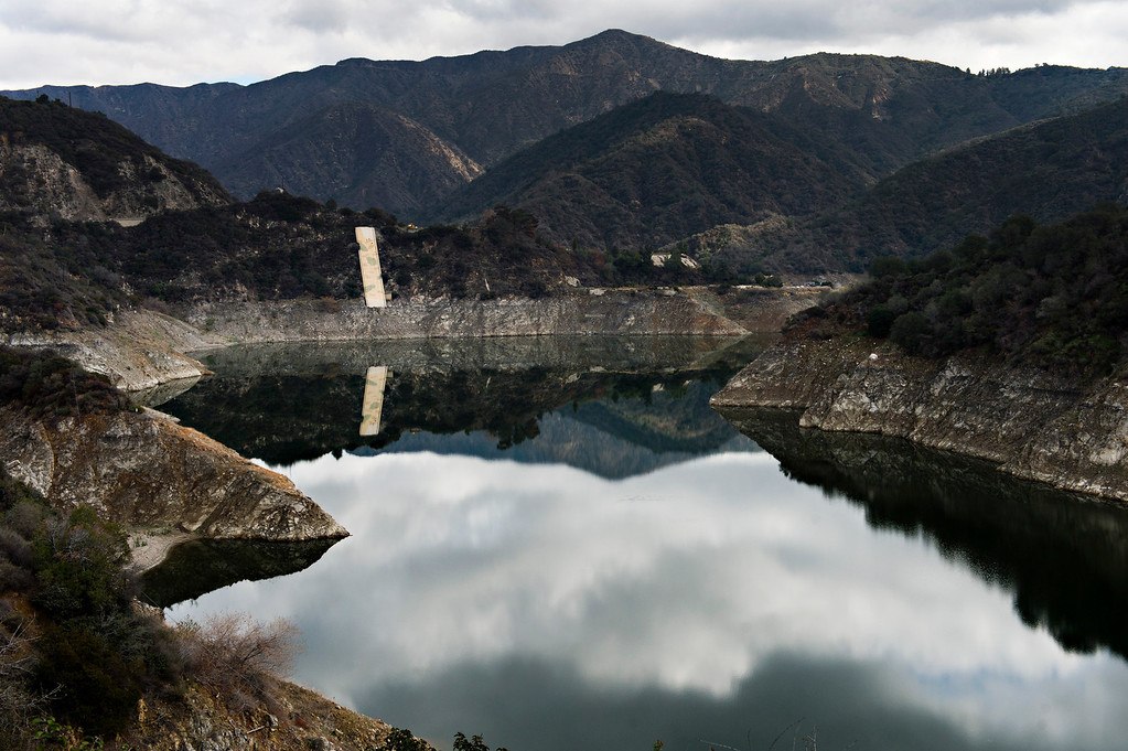. Rings around Morris Dam in the Angeles National Forest  show the declining water level from past years in the on Friday, Feb. 7, 2014.  Southern California is in the third year of drought. (Photo by Watchara Phomicinda/ San Gabriel Valley Tribune)