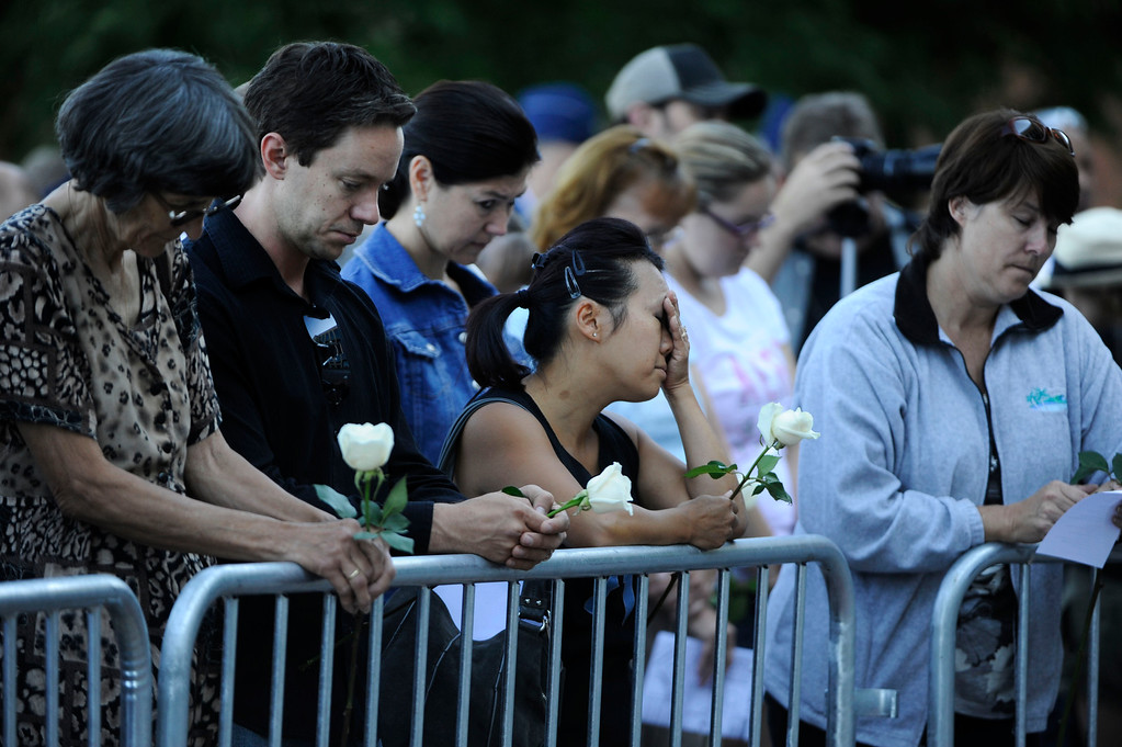 . AURORA, CO - JULY 20:  Linda Klosowski, center, reflects during a prayer at the 7/20 Day of Remembrance 2013 at the Aurora Municipal Center Saturday morning, July 20, 2013. Over 200 people attended the service in honor of the 12 people killed and over 60 people injured in last years Aurora theater shooting. The service included prayer, songs and speeches from local officials and the Governor of Colorado, John Hickenlooper. Klosowski\'s daughter was in the theater the night of the shooting, is physically well, but suffering emotionally. (Photo By Andy Cross/The Denver Post)