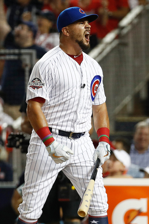 . Chicago Cubs Kyle Schwarber (12) reacts to his home run hit during the MLB Home Run Derby, at Nationals Park, Monday, July 16, 2018 in Washington. The 89th MLB baseball All-Star Game will be played Tuesday. (AP Photo/Patrick Semansky)