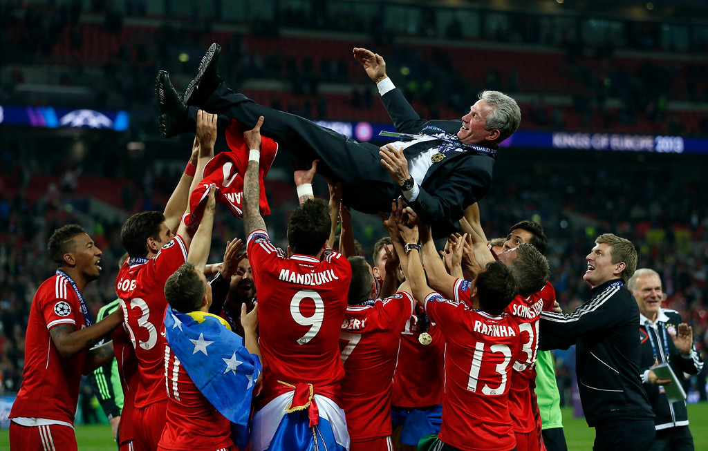 . Bayern Munich players throw their coach Jupp Heynckes into the air as they celebrate winning the Champions League final soccer match at Wembley stadium in London May 25, 2013. Bayern Munich beat Borussia Dortmund 2-1 in an all-German Champions League final on Saturday to become European champions for the fifth time.                  REUTERS/Stefan Wermuth