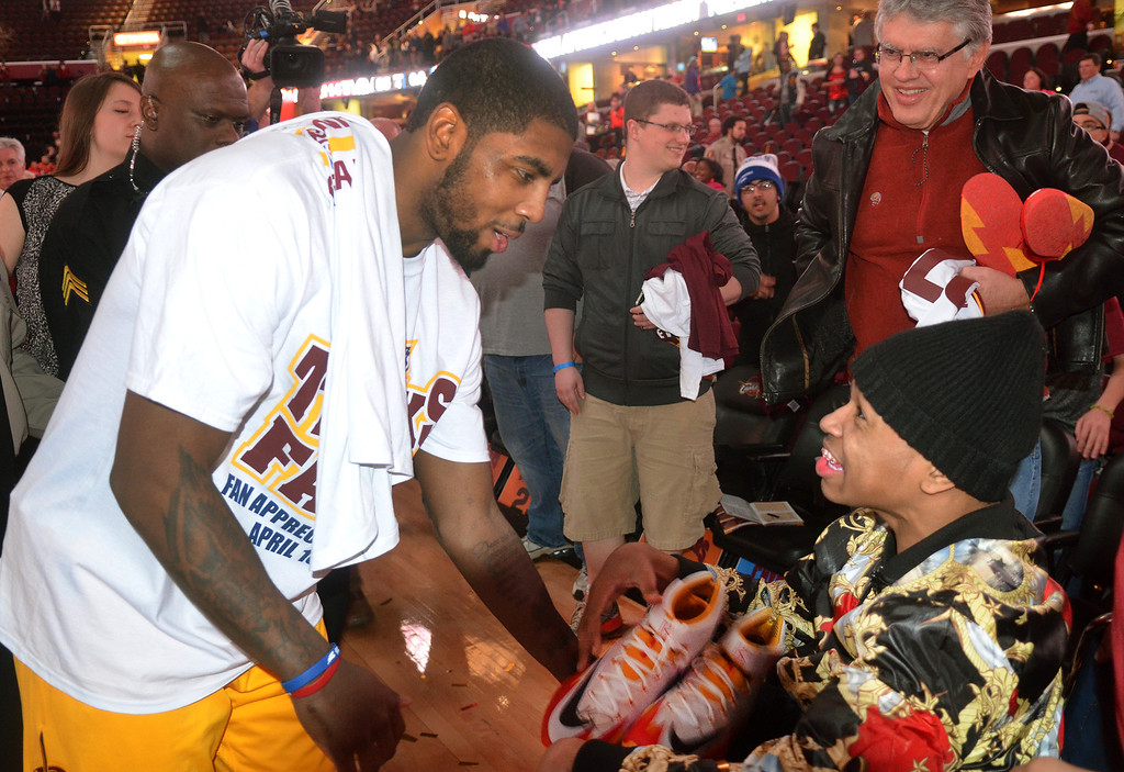 . Michael Allen Blair/Digital First Media Cavs\' guard Kyrie Irving gives a pair of basketball shoes to a wheelchair bound Cavs\' fan during Fan Appreciation Night April 16 at Quicken Loans Arena. The Cavs defeated the Nets 114-85. Big questions remain with Irving heading into the final year of his contract next season.