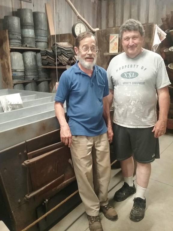 . Chuck Hendricks (left) of Claridon Township and Bill Jackson of Chardon are part of the core team responsible for the making of the Maple Syrup Museum. They are shown inside the structure which is filled with many original pieces used in early maple syrup production. (Jean Bonchak)