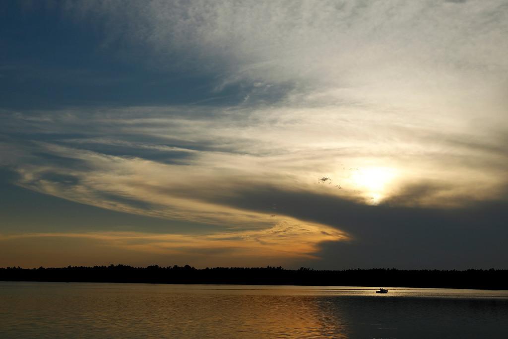. Minnesota # 3.  A fishing boat travels across Rock Lake as the sun sets near Pequot Lakes, Minnesota, Thursday, July 19, 2012.   (AP Photo/Ann Heisenfelt)