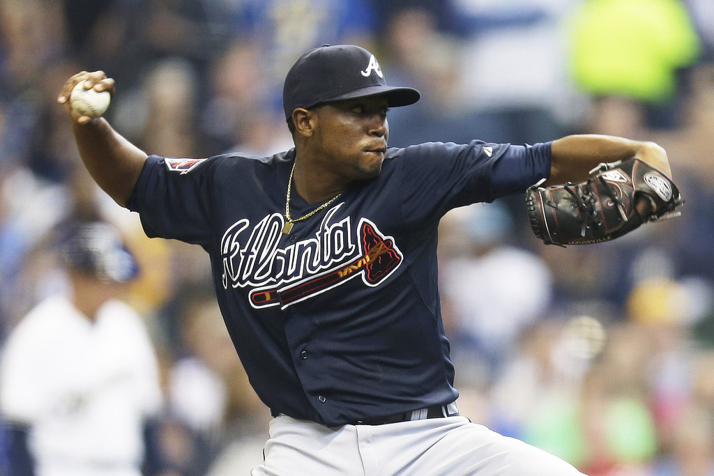 . Julio Teheran #49 of the Atlanta Braves pitches during the bottom of the first inning against the Milwaukee Brewers during Opening Day at Miller Park on March 31, 2014 in Milwaukee, Wisconsin. (Photo by Mike McGinnis/Getty Images)