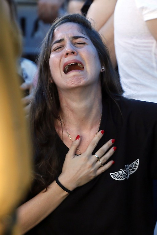 . A relative of 21-year-old Israeli St.-Sgt. Matan Gotlib, mourns during his funeral at the military cemetery in the Israeli costal city of Rishon Letzion on July 31, 2014, after he was killed the previous day in combat in the Gaza Strip. Israel said it would not pull troops from Gaza until they finish destroying a network of cross-border tunnels, and the army confirmed mobilising another 16,000 additional reservists, hiking the total number called up to 86,000. AFP PHOTO/ GALI TIBBON/AFP/Getty Images