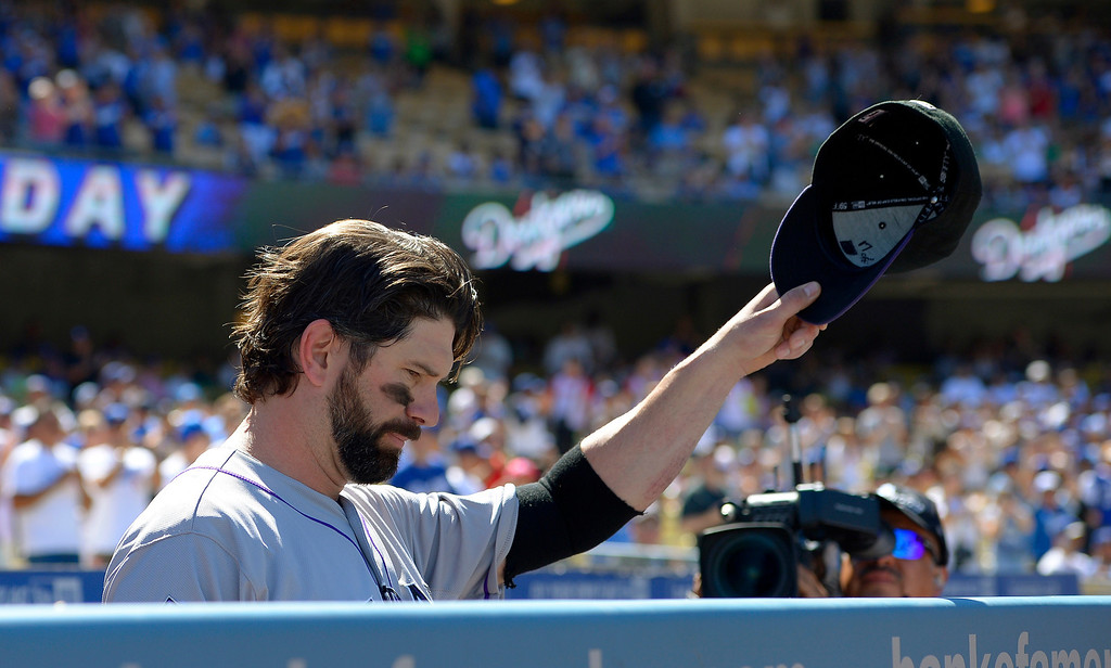 . Colorado Rockies first baseman Todd Helton acknowledges fans after watching a video tribute to him prior to the Rockies\' baseball game against the Los Angeles Dodgers, Sunday, Sept. 29, 2013, in Los Angeles. Helton is retiring after the season. (AP Photo/Mark J. Terrill)
