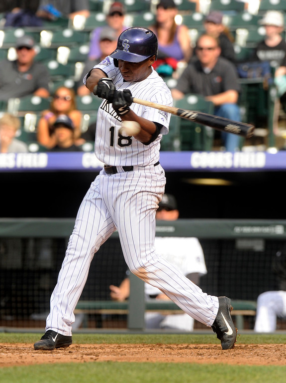 . Jonathan Herrera hit into a double play to end the game. The Colorado Rockies were defeated by the Miami Marlins 5-3 at Coors Field Thursday afternoon, July 25, 2013. Photo By Karl Gehring/The Denver Post