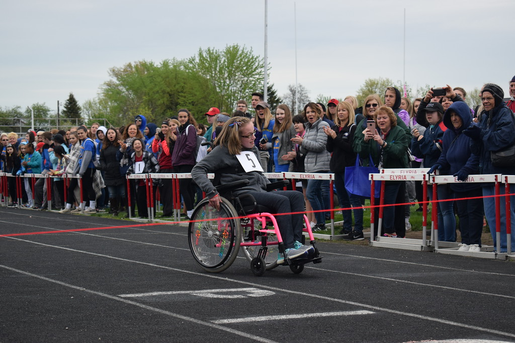 . Briana Contreras � The Morning Journal <br> Mila Radanovich, 15, of General Johnnie Wilson Middle School in Lorain races to the finish line during her 25 Meter Wheelchair Race at the 38th Annual Lorain County Special Olympics Track and Field Event held on May 11 at Ely Stadium in Elyria.