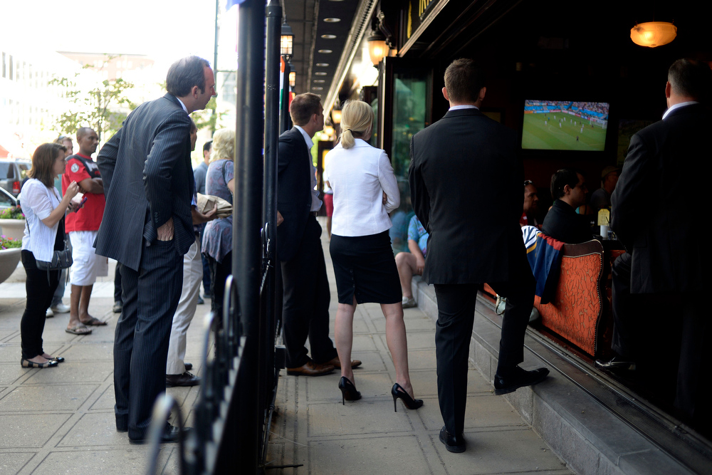 . Fans stop on the sidewalk to join fans on the inside to watch the U.S.A. versus Germany World Cup group match. Fans gathered at Katie Mullen\'s on Thursday, June 26, 2014. (Photo by AAron Ontiveroz/The Denver Post)
