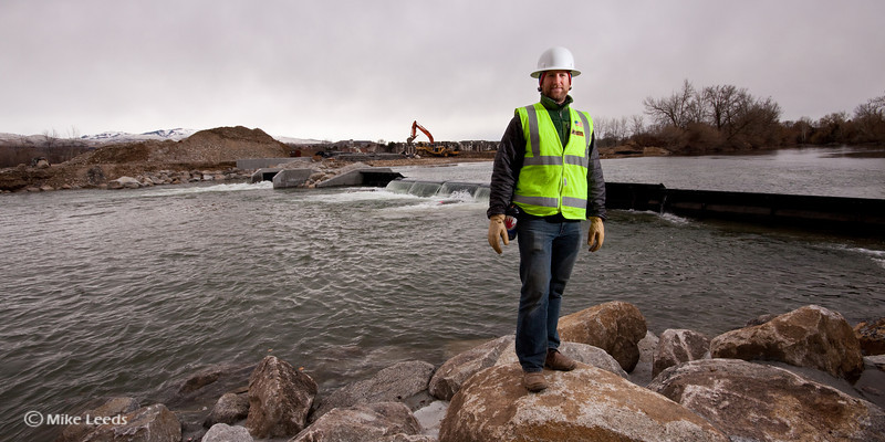 Walt McBrier standing in front of the new Boise Whitewater Park, 1st day of water passing through the features.