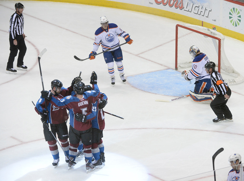 . DENVER, CO. - DECEMBER 19: The Colorado Avalanche celebrated a short-handed goal in the second period which gave the team its first lead of the game.  The Colorado Avalanche hosted the Edmonton Oilers in an NHL game at the Pepsi Center Thursday night, December 19, 2013.  Photo By Karl Gehring/The Denver Post