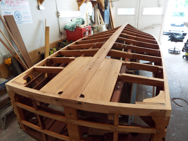 Rear view of all the new frames, keel, and chines coated with epoxy ready to have the new bottom skin applied.