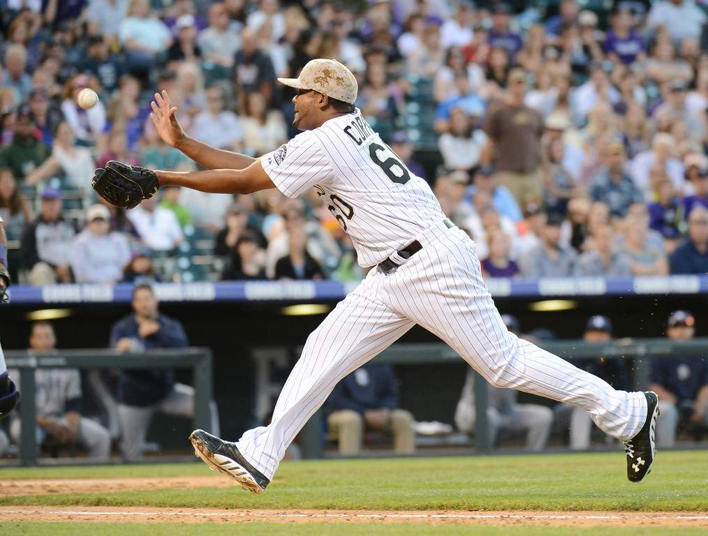 . Denver, CO. - June 08: Manuel Corpas of Colorado Rockies (60) catch the ball bunted by Chris Denorfia of San Diego Padres (13) in the 8th inning of the game at Coors Field. Denver, Colorado. June 8, 2013. San Diego won 4-2. (Photo By Hyoung Chang/The Denver Post)