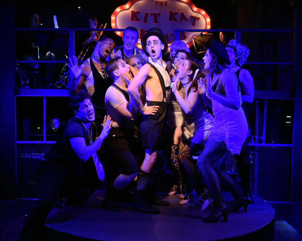 ". Devon Turchan as the Emcee, center, is surrounded by the Kit Kat Klub girls and boys in a scene from the Blank Canvas production of �Cabaret.� The show continues through Dec. 17. For more information, visit <a href=""http://www.blankcanvastheatre.com/\"">blankcanvastheatre.com</a>. (Andy Dudik)"