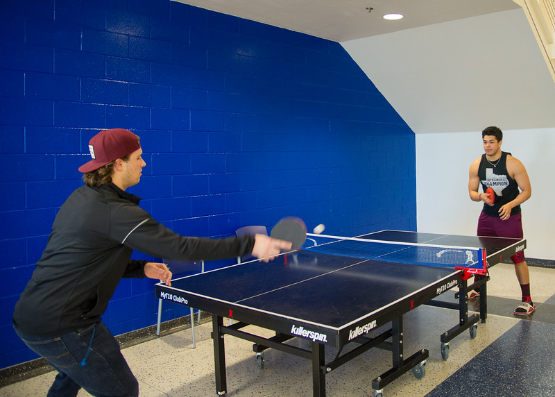 Students Nick Lopez and Jordan Tittle face off against one another in a game of ping pong.