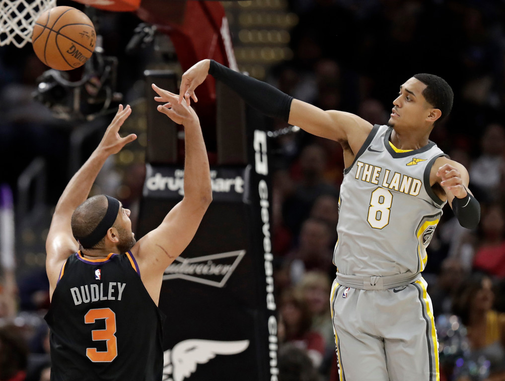 . Cleveland Cavaliers\' Jordan Clarkson (8) passes the ball over Phoenix Suns\' Jared Dudley (3) during the second half of an NBA basketball game Friday, March 23, 2018, in Cleveland. The Cavaliers won 120-95. (AP Photo/Tony Dejak)
