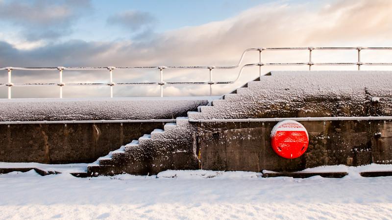 Snow on Helmsdale sea wall