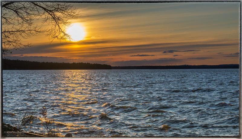 Sunset Over Choppy River