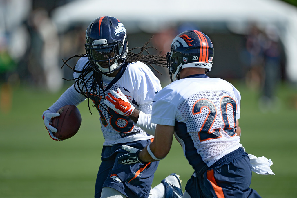 . Denver Broncos strong safety Quinton Carter (38) runs through drills with Denver Broncos strong safety John Boyett (20) during the first day of the Denver Broncos 2014 training camp July 24, 2014 at Dove Valley. (Photo by John Leyba/The Denver Post)